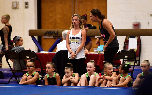 7/14/2018 Mike Orazzi | Staff Gymnasts watch as Olivia Tenan performs in the floor exercise at the Nutmeg Games Gymnastics competition held at New Britain High School Saturday.