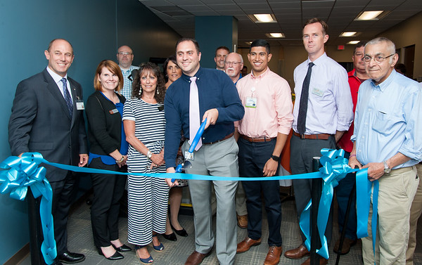 07/17/18 Wesley Bunnell | Staff The Hospital for Special Care held a ribbon cutting at its location at 5 Fenn Rd in Newington on Tuesday evening. Executive Director Eric Sullen, L, Gail Whitney Executive Director Newington Chamber of Commerce, 3rd L, Physical Therapy Supervisor Matthew Kurimai, cutting ribbon, Physical Therapist Faraaz Bhura, Medical Director Dr. Colin Stack , Mayor Roy Zartarian.