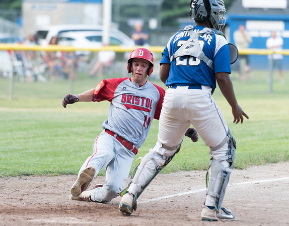 07/16/18 Wesley Bunnell | Staff Bristol defeated Plainville in legion baseball on Monday night at Trumbull Park in Plainville. Alec Diloreto (14) heads home as catcher Juan Camacho (23) awaits the throw.
