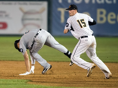 07/03/18  Wesley Bunnell | Staff  The New Britain Bees vs the Long Island Ducks on July 3rd at New Britain Stadium. Reid Brignac (15) after applying the tag on the Long Island runner.