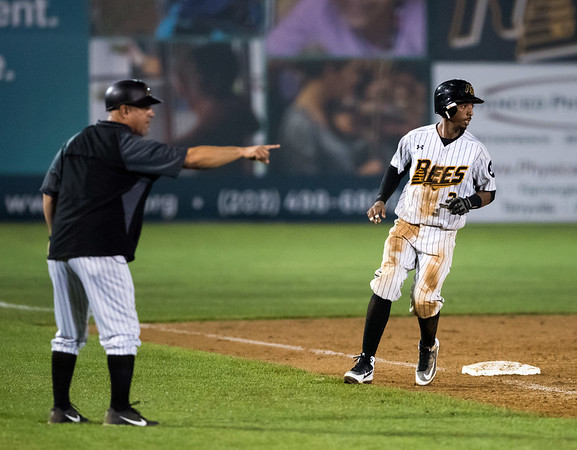 07/03/18 Wesley Bunnell | Staff The New Britain Bees vs the Long Island Ducks on July 3rd at New Britain Stadium. Catcher James Skelton (3) rounds third and looks at the play unfold at first base.