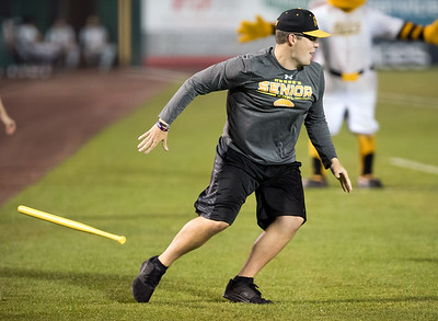 07/03/18  Wesley Bunnell | Staff  The New Britain Bees vs the Long Island Ducks on July 3rd at New Britain Stadium. A fan competing in the dizzy bat competition.