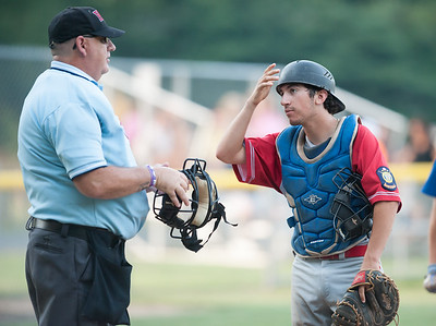 07/16/18  Wesley Bunnell | Staff  Bristol defeated Plainville in legion baseball on Monday night at Trumbull Park in Plainville. Catcher David Bernier (5) talks with the home plate umpire between innings.