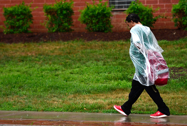 7/17/2018 Mike Orazzi | Staff A man walks in the rain along North Main Street in Bristol Tuesday afternoon.