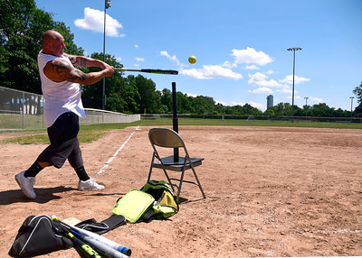 7/18/2018 Mike Orazzi | Staff Steve Bashaw, a physical education teacher at the Ellen P. Hubbell School, while hitting some softballs at Casey Field in Bristol Wednesday afternoon.