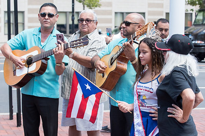 07/20/18  Wesley Bunnell   Staff  The Puerto Rican flag was raised in Central Park on Friday at noon in recognition of Saturday's Puerto Rican Festival. Pedro Alvarez and Junior Lopez play La Borinquena which is the national anthem of Puerto Rico as the Queen of the Puerto Rican Society Milagros Fontanez. age 13. waves the flag.
