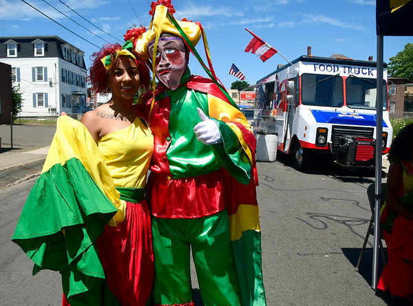 7/21/2018 Mike Orazzi | Staff Kineysha Rivera and Giovanni Sanchez during the annual Puerto Rican Festival held on High Street in New Britain Saturday.