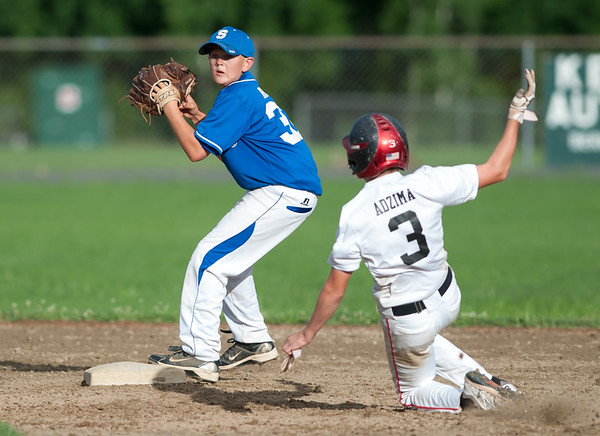 07/24/18 Wesley Bunnell | Staff Southington vs Stratford Titans in 13U Nutmeg Games baseball at Percival Field on Tuesday afternoon. Nat Cofrancesco (32) looks to turn the double play as Stratford's Joe Adzima (3) slides.
