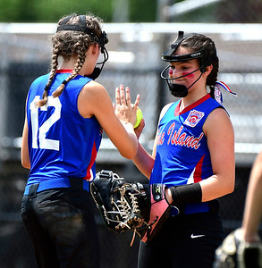 7/25/2018 Mike Orazzi | Staff Rhode Island's Gabrielle Jeffery (12) and Paige Cote (10) during a win over Delaware at Breen Field in Bristol Tuesday afternoon.
