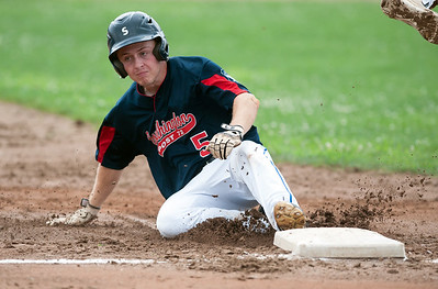 07/25/18  Wesley Bunnell   Staff  Southington Post 72 vs Trumbull in American Legion Baseball on Wednesday afternoon. Daniel Topper (5) slides safely into third as the throw from the Trumbull catcher sails into left field.