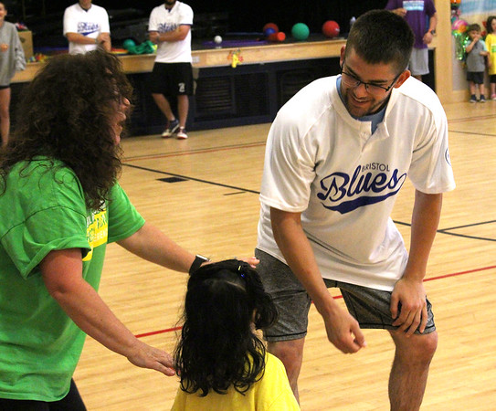 07/25/2018 Courtney Rush | Photographer Bristol Blues player and counselor instruct a camper at Mountain View school Bristol, CT