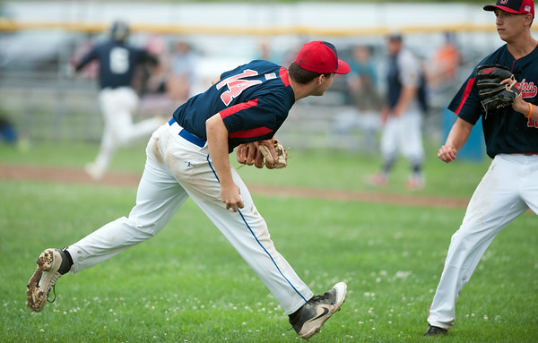 07/25/18 Wesley Bunnell | Staff Southington Post 72 vs Trumbull in American Legion Baseball on Wednesday afternoon. Jeremy Mercier (14) fields a ball hallway up the third base line.