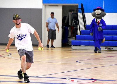 7/27/2018 Mike Orazzi | Staff Bristol Blues's Ethan Hunt tosses tennis balls to teammate Mike DeLease while at the Bristol Boys & Girls Club on West Street Friday morning.
