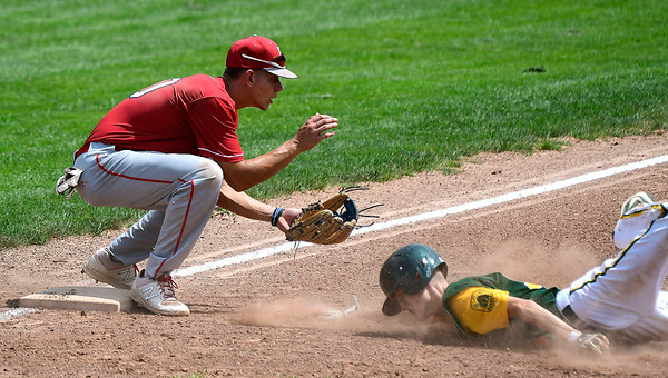 7/27/2018 Mike Orazzi | Staff Bristol American Legion's MacGregor Goulet (10) and RCP's Brett Thivierge (14) during the state tournament held at Tunxis Meade Field in Farmington Friday afternoon.