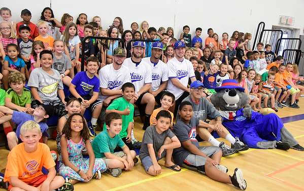 7/27/2018 Mike Orazzi | Staff Members of the Bristol Blues baseball team meet with children at the Bristol Boys & Girls Club on West Street Friday morning.