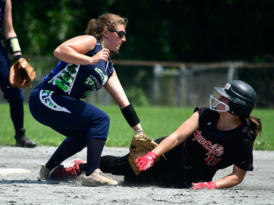 7/28/2018 Mike Orazzi | Staff CT Titans Softball's Megan Sharon (48) and the Cheshire Wildcats' Allie Kirk (11)  the Saturday morning at Sage Park in Berlin.