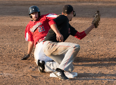 07/31/18  Wesley Bunnell | Staff  Southington vs Cheshire in the American Legion State Tournament at Ceppa Field in Meriden on Tuesday night. Dylan Chiaro (21) on an attempted steal of third but was thrown out.