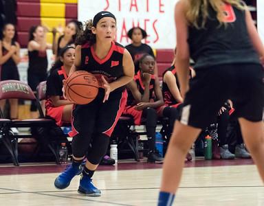 07/31/18  Wesley Bunnell | Staff  The CT Heat (New Britain) vs Trinity Eagles in Nutmeg Games 7th grade girls basketball played at New Britain High School. Eilyn Maldonado (2).