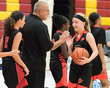 07/31/18  Wesley Bunnell | Staff  The CT Heat (New Britain) vs Trinity Eagles in Nutmeg Games 7th grade girls basketball played at New Britain High School. Haileigh Orzel (1), R, shakes hands with the coach after the game.