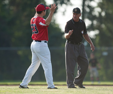 07/31/18  Wesley Bunnell | Staff  Southington vs Cheshire in the American Legion State Tournament at Ceppa Field in Meriden on Tuesday night. A Southington coach argues a call at second base that initially ruled the Southington runner out but was reversed.
