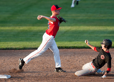 07/31/18  Wesley Bunnell | Staff  Southington vs Cheshire in the American Legion State Tournament at Ceppa Field in Meriden on Tuesday night. Jake Romano (8) pivots and turns the double play.