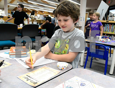 7/31/2018 Mike Orazzi | Staff Liam Moulton,7, while celebrating  Harry Potter's birthday during Harry Potter Day at the  Manross Library in Forestville Tuesday afternoon.
