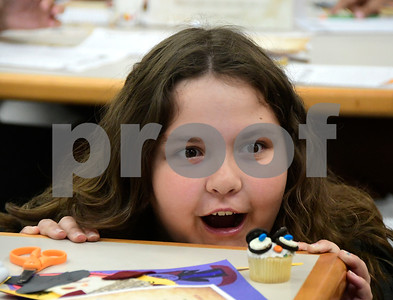 7/31/2018 Mike Orazzi | Staff Riley Livingston,10, stares at a cupcake she made while celebrating  Harry Potter's birthday during Harry Potter Day at the  Manross Library in Forestville Tuesday afternoon.