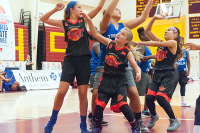 07/31/18  Wesley Bunnell | Staff  The CT Heat (New Britain) vs Trinity Eagles in Nutmeg Games 7th grade girls basketball played at New Britain High School. Bria Block (9), Emily Arel (6) and Lyana Mendez (8).