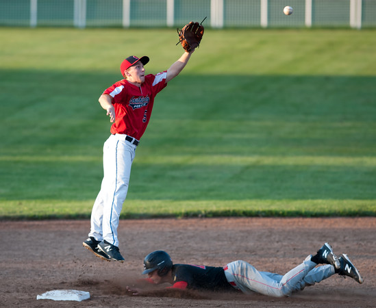 07/31/18 Wesley Bunnell | Staff Southington vs Cheshire in the American Legion State Tournament at Ceppa Field in Meriden on Tuesday night. Daniel Topper (5) leaps to field the throw from the catcher.