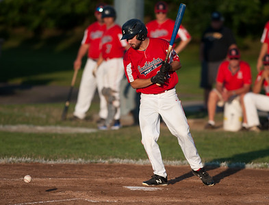 07/31/18  Wesley Bunnell | Staff  Southington vs Cheshire in the American Legion State Tournament at Ceppa Field in Meriden on Tuesday night. Dylan Chiaro (21) looks down at the ball after being hit by the pitch.