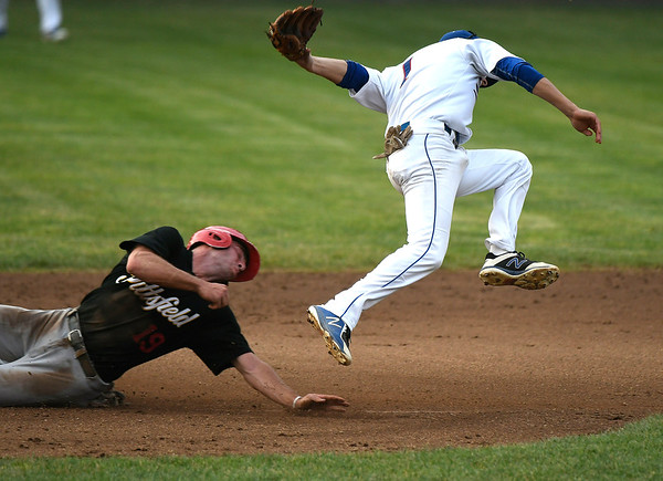7/3/2018 Mike Orazzi | Staff The Bristol Blues' Alex Loparco (1) as the Pittsfield Suns' Severino Simeone (19) slides safely into second Tuesday night at Muzzy Field.