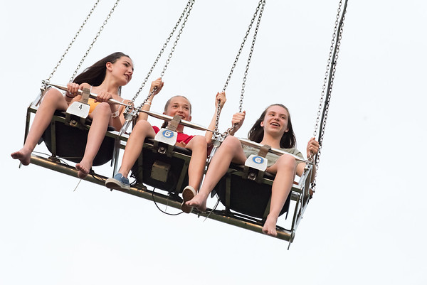 07/03/18 Wesley Bunnell | Staff Friends Brielle Dumont, L, Brianna Demorais and Jenna Wenzel ride Sky Hawk at the Berlin Fair Grounds on Tuesday evening. From Tuesday through Saturday Dreamland Amusements is holding Freedom Fest at the the Berlin Fairgrounds featuring carnival rides, entertainment and fireworks on Wednesday and Saturday at 9:30pm.