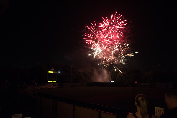 07/03/18 Wesley Bunnell | Staff Spectators at the Alvarium Beer Hive enjoy fireworks beyond the left center field wall at New Britain Stadium following a New Britain Bees victory of the Long Island Ducks on Tuesday July 3rd in honor of Independence Day.