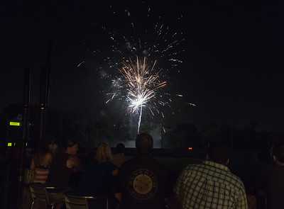 07/03/18  Wesley Bunnell   Staff  Spectators at the Alvarium Beer Hive enjoy fireworks beyond the left center field wall at New Britain Stadium following a New Britain Bees victory of the Long Island Ducks on Tuesday July 3rd in honor of Independence Day.