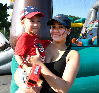 7/4/2018 Mike Orazzi   Staff Ethan Irizarry,2, and his mother Charlotte Rodriquez while in New Britain's Stanley Quarter Park for 4th of July events Wednesday.