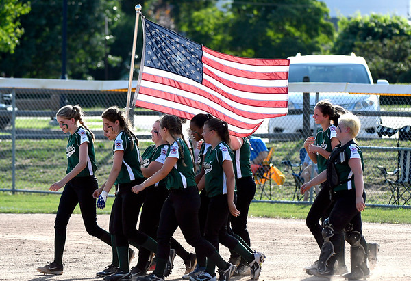 7/5/2018 Mike Orazzi | Staff Bristol girls carry the American flag at the start of Thursday nights District 5 softball game with Plainville at Casey Field in Bristol.