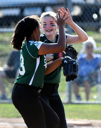 7/5/2018 Mike Orazzi | Staff Bristol's Kayla St. Onge (16) and Jasmine Perez (13) during Thursday nights District 5 softball game with Plainville at Casey Field in Bristol.