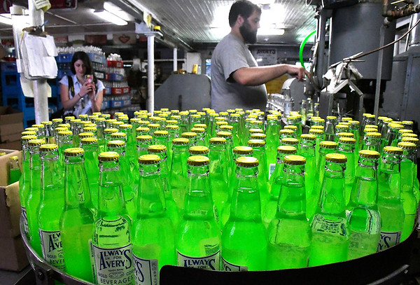 7/7/2018 Mike Orazzi | Staff Avery Beverage's Forrest Zirpolo bottles soda Saturday.