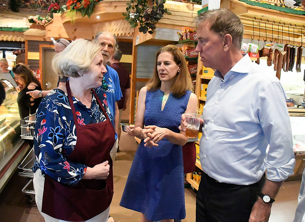 7/7/2018 Mike Orazzi | Staff Roly Poly's Vira Nikiforova talks with Democratic Governor candidate Ned Lamont and Lt. Governor candidate Susan Bysiewicz during a walking tour in New Britain Saturday.