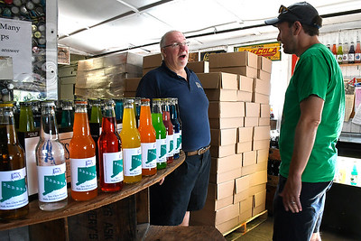 7/7/2018 Mike Orazzi | Staff Connecticut Senator Chris Murphy (right) while talking to Avery Beverage Manager Rob Metz during part of this walking tour of the state Saturday.