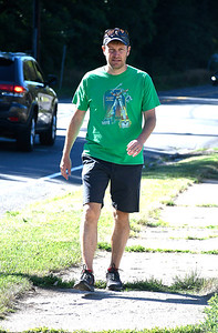 7/7/2018 Mike Orazzi | Staff Connecticut Senator Chris Murphy walks along Route 372 on his way to Avery Beverage during part of this walking tour of the state Saturday.