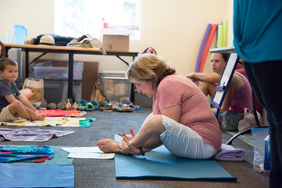 "Yoga instructor Christina Maniccia led ""Family yoga"" at the Davidson Library. (BillGiduz photo)"