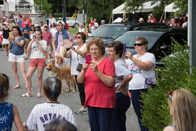 The parade was cheered (and recorded by man) on Main Street. (Bill Giduz photo)