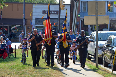 After coming down South Street the Davidson Police Department color guard led the parade along the sidewalk adjacent to the Town Green.