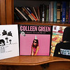 Some of musician Colleen Green's albums, including her first, left, and her latest, center. Green is  originally from Dunstable, now of Lowell.  SUN/Julia Malakie