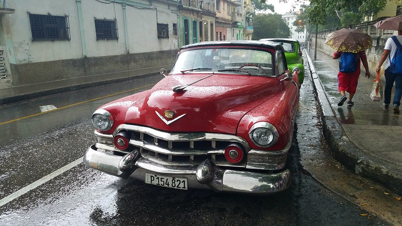 Antique cars line the downtown streets of Havana, Cuba near Universidad de la Habana on a rainy afternoon on March 12, 2018. JACOB VITALI/LOWELL SUN