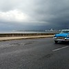 An antique car passing along El Malecón in Havana, Cuba on March 12, 2018. JACOB VITALI/LOWELL SUN.