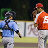 VON CASTOR/Special to the Phoenix<br /> Fort Gibson's Seth Martin and Oktaha's Brayden Rohden discuss pitch selection Tuesday night in the Boys Large School All-State game at Oral Roberts University in Tulsa.