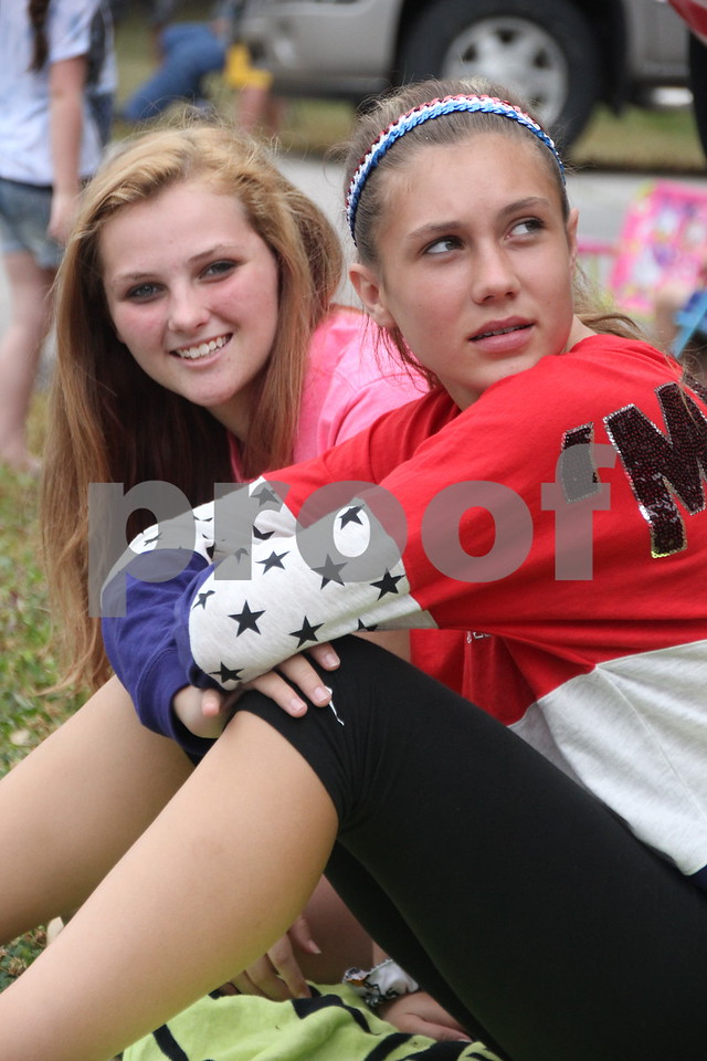 Watching the parade  (left to right) is: Brianna Benning and Brooke Varland. The Otho Fourth of July Parade took place in Otho on July 4, 2016.