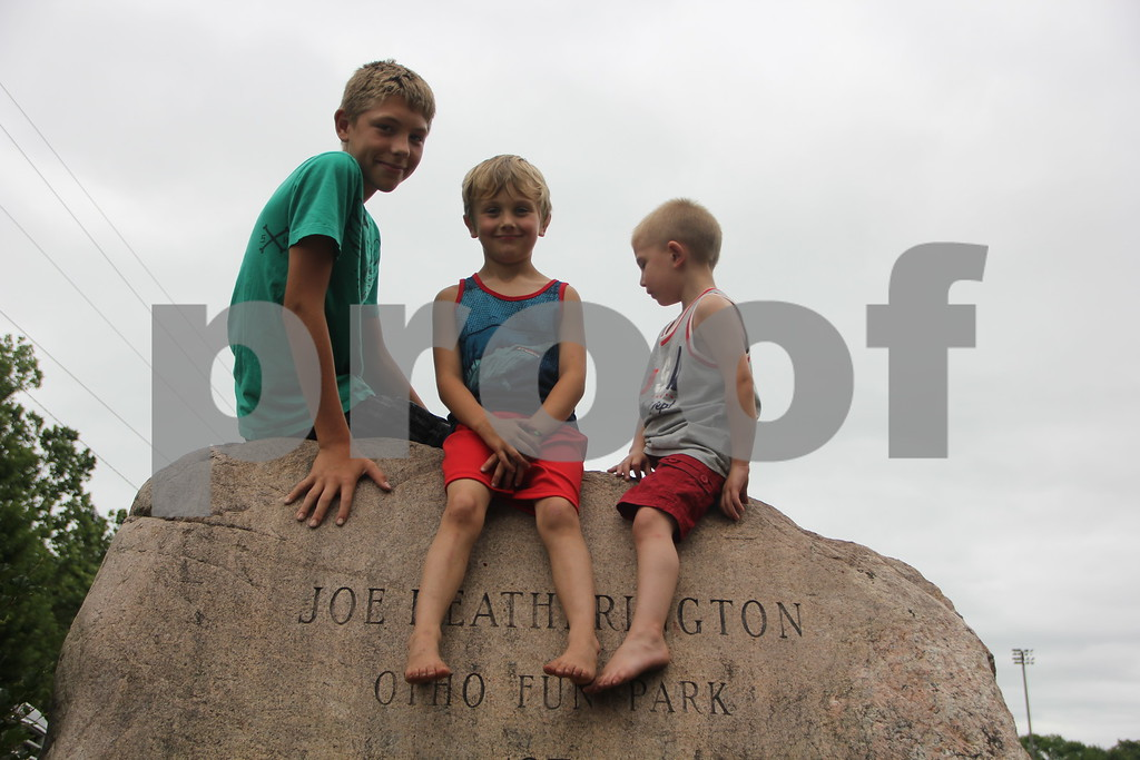 July 4, 2016 the Otho Fourth of July Parade took place in Otho. (Seen left to right) Andrew Black, Piersun Black, and Landyn Lawler  found a vantage point from atop a rock to watch the parade from and waited for the parade to start .